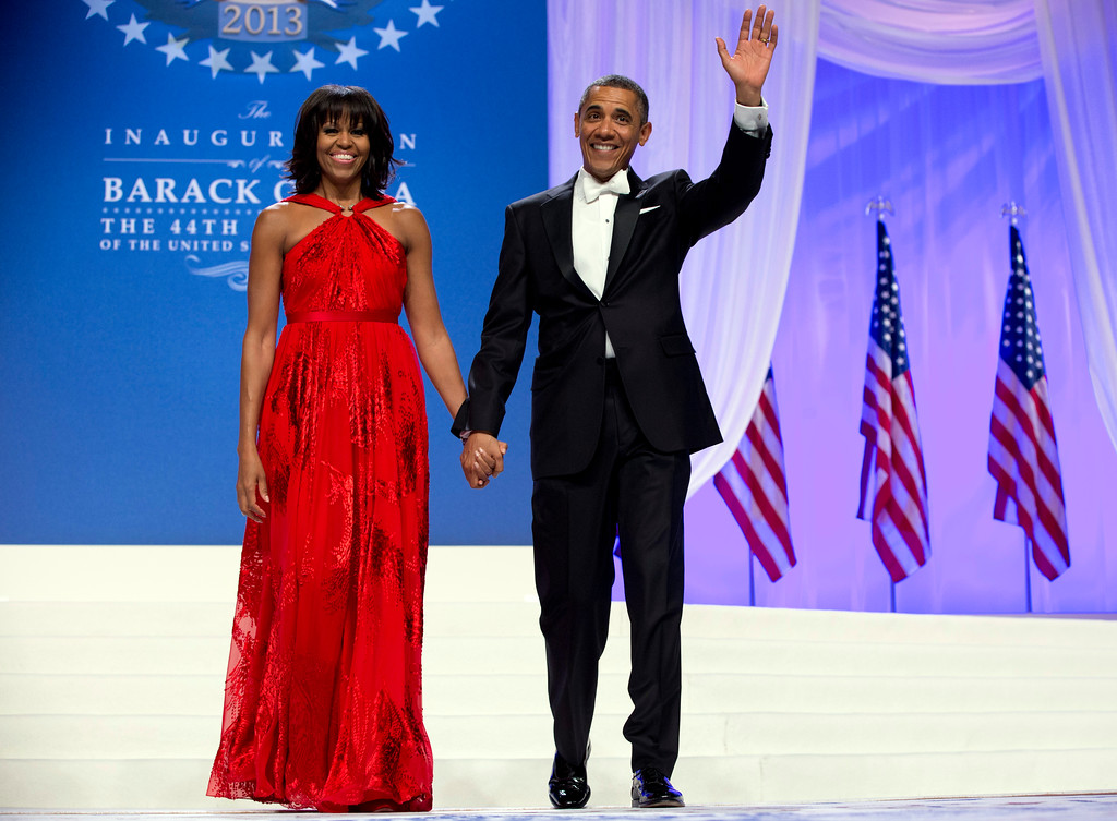 . President Barack Obama and first lady Michelle Obama arrive to dance together at an Inaugural Ball, Monday, Jan. 21, 2013, at the Washington Convention Center in Washington, during the 57th Presidential Inauguration. (AP Photo/Carolyn Kaster)