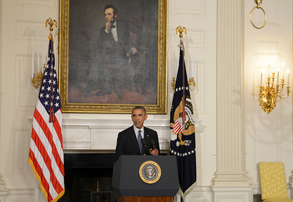 . WASHINGTON, DC - AUGUST 7: (AFP OUT) U.S. President Barack Obama addresses the nation from the State Dining Room of the White House on August 7, 2014 in Washington, DC. Obama announced he has authorized military strikes against the Islamic State of Iraq and the Levant (ISIS) and a humanitarian aid drop. ISIS has been advancing on the important city of Erbil, Iraq and a civilian humanitarian crisis has developed.   (Photo by Mike Theiler-Pool/Getty Images)