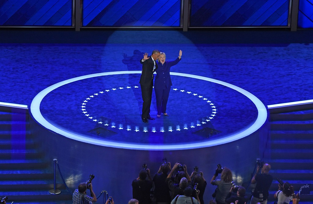 . US President Barack Obama and US Democratic presidential candidate Hillary Clinton wave after his address to the Democratic National Convention at the Wells Fargo Center in Philadelphia, Pennsylvania, July 27, 2016. (TIMOTHY A. CLARY/AFP/Getty Images)