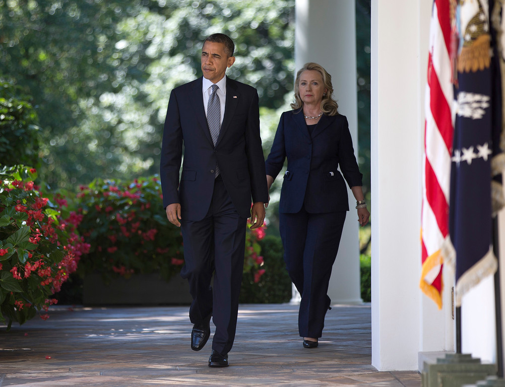 . Secretary of State Hillary Clinton walks with President Barack Obama to the Rose Garden of the White House in Washington, Wednesday, Sept. 12, 2012, where he spoke about the death of U.S. ambassador to Libya Christopher Stevens.  (AP Photo/Evan Vucci)