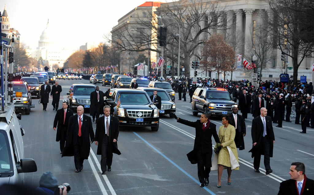 . US President Barack Obama and his wife Michelle wave to supporters as they walk along Pennsylvania Ave during the parade following his inauguration as the 44th US president of the United States in Washington, DC on January 20, 2009.       (ROBYN BECK/AFP/Getty Images)