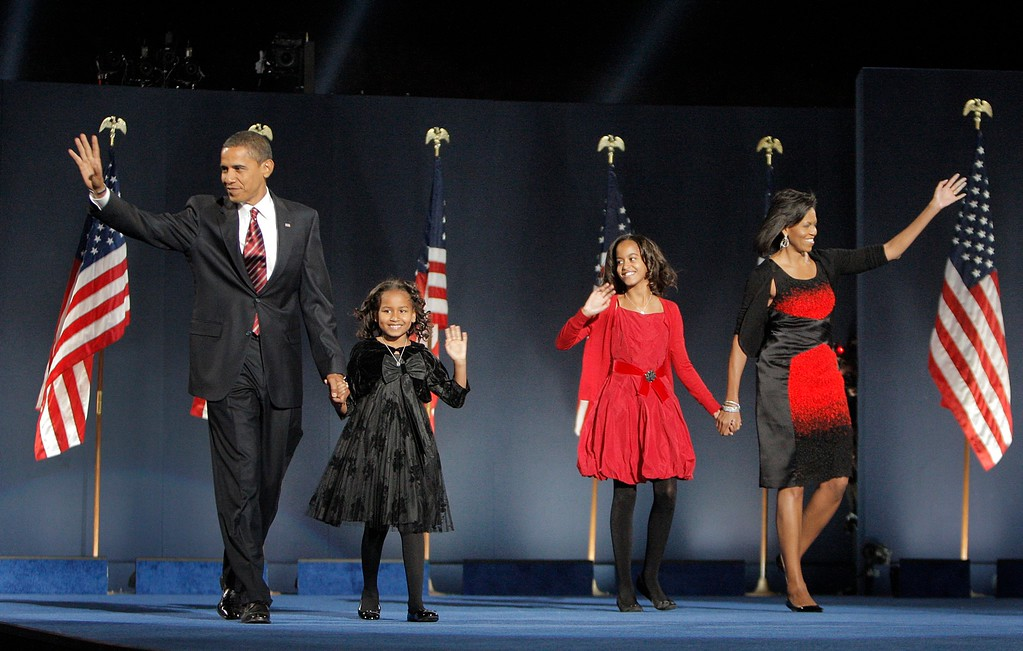 . President-elect Barack Obama, left, his wife Michelle Obama, right, and two daughters, Malia, and Sasha, center left, wave to the crowd at the election night rally in Chicago, Tuesday, Nov. 4, 2008. (AP Photo/Jae C. Hong)