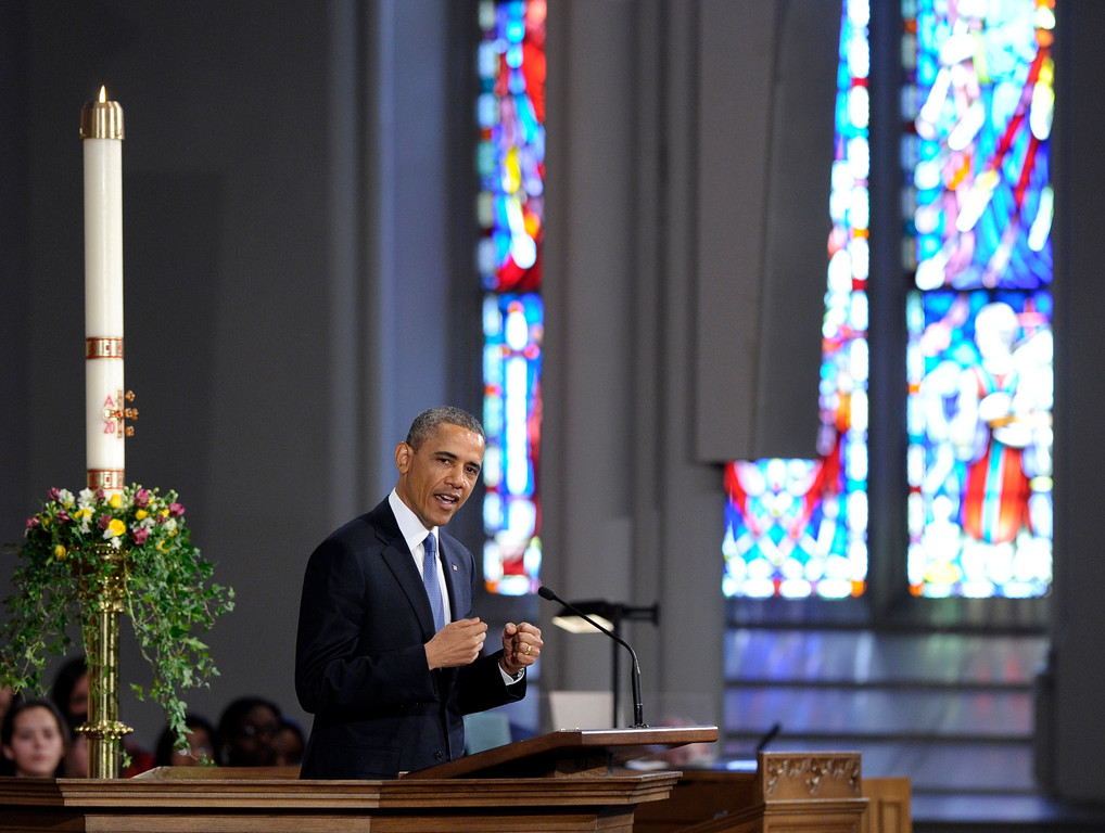 ". President Barack Obama speaks at the ""Healing Our City: An Interfaith Service\"" at the Cathedral of the Holy Cross in Boston, Thursday, April 18, 2013. The service is dedicated to those who were gravely wounded or killed in Monday�s bombing near the finish line of the Boston Marathon.(AP Photo/Susan Walsh)"