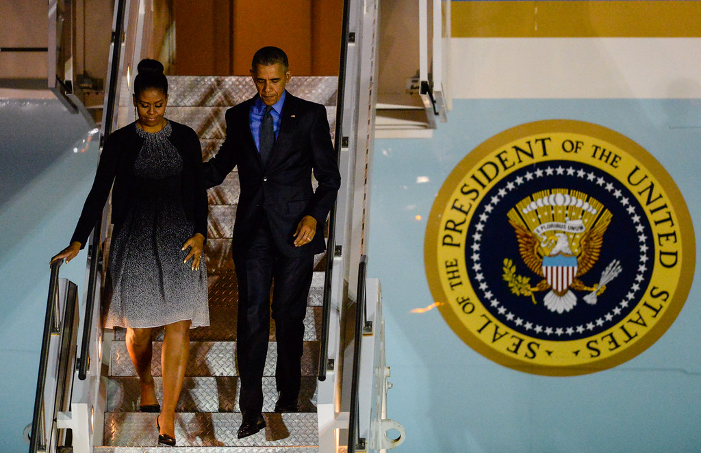 . President Barack Obama and First Lady Michelle Obama exit Air Force One as they arrive to San Bernardino International Airport in San Bernardino, CA on Friday, Dec. 18, 2015. The President and First Lady privately visited with families of the 14 San Bernardino mass shooting victims. (Photo by Rachel Luna/The Sun)