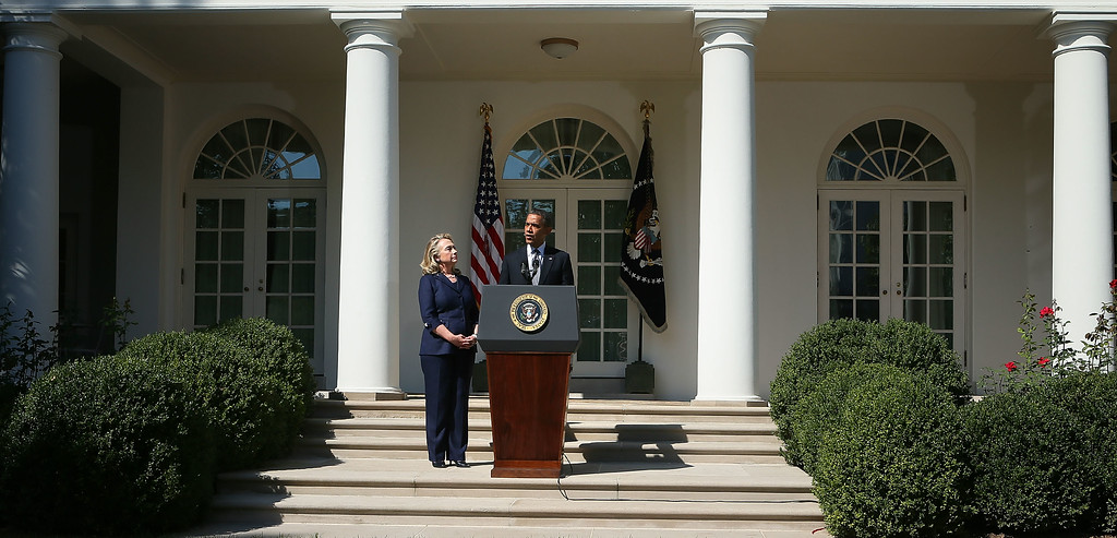 . WASHINGTON, DC - SEPTEMBER 12:  U.S. President Barack Obama (R) makes a statement in response to the attack at the U.S. Consulate in Libya as Secretary of State Hillary Clinton (L) looks on September 12, 2012 at the Rose Garden of the White House in Washington, DC. U.S. Ambassador J. Christopher Stevens and three other Americans were killed in an attack on the U.S. Consulate in Benghazi, Libya by protesters who were potentially angry over a controversial Prophet Muhammad video.  (Photo by Alex Wong/Getty Images)
