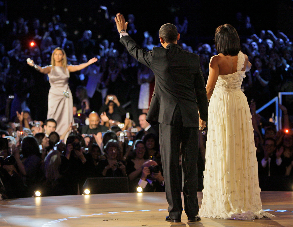 . President Barack Obama, left, and first lady Michelle Obama wave to singer Beyonce after their first dance together at the Neighborhood Inaugural Ball in Washington, Tuesday, Jan. 20, 2009.  (AP Photo/Alex Brandon) (AP Photo/Elise Amendola)