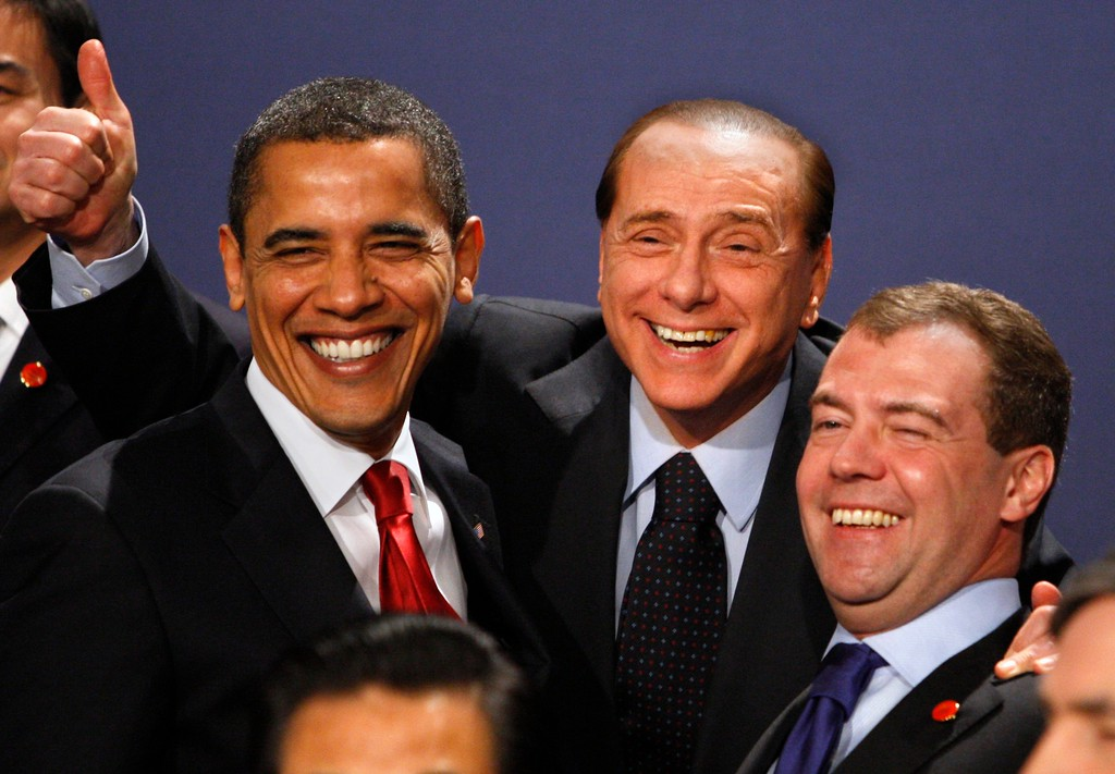 . U.S. President Barack Obama,left.  smiles with Italian Prime Minister Silvio Berlusconi, centre, and Russian President Dmitry Medvedev during a group photo  at the G20 Summit in  the Excel centre in London, Thursday, April 2, 2009. The objective of the London Summit is to bring the world\'s biggest economies together to help restore global economic growth through enhanced international coordination. (AP Photo/Kirsty Wigglesworth)