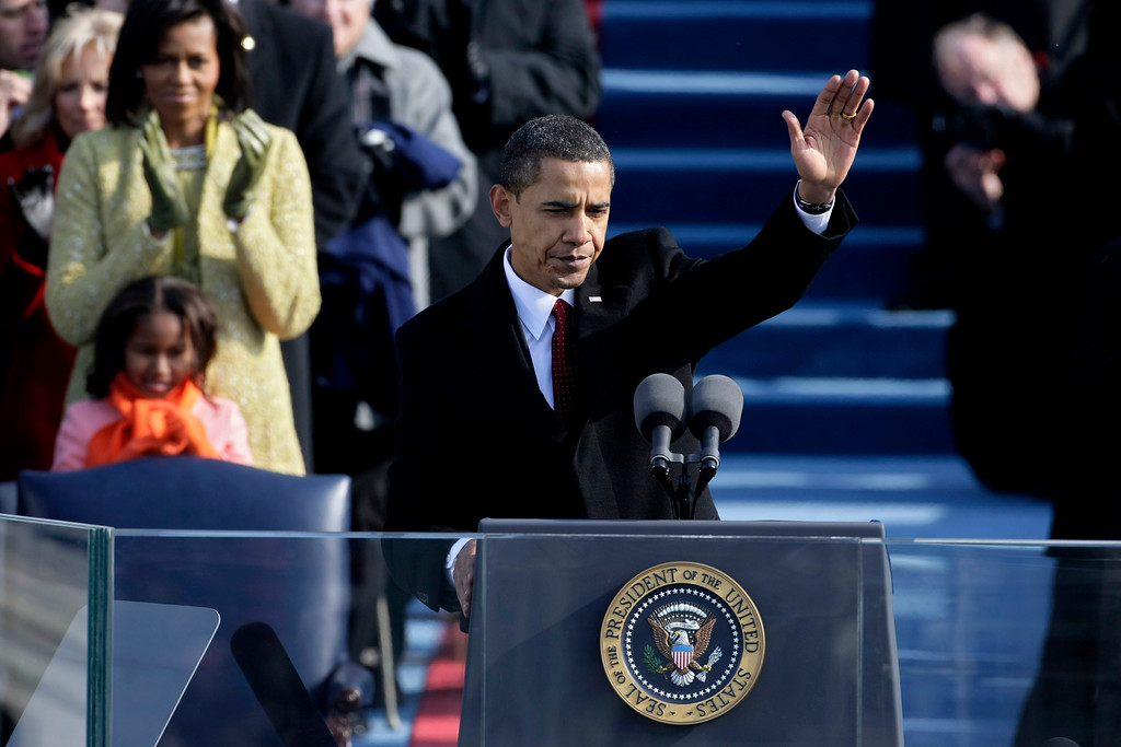 . WASHINGTON - JANUARY 20:  U.S President Barack Obama waves after his inaugural address during his inauguration as the 44th President of the United States of America on the West Front of the Capitol January 20, 2009 in Washington, DC. Obama becomes the first African-American to be elected to the office of President in the history of the United States.  (Photo by Alex Wong/Getty Images)