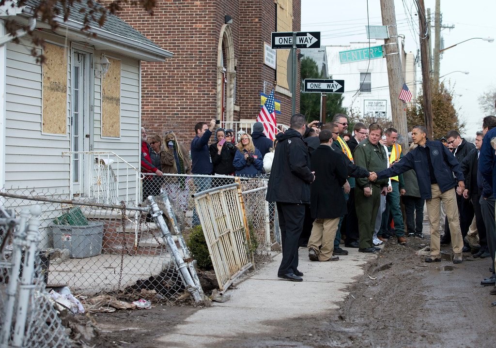 . President Barack Obama visits with people on Cedar Grove Avenue, a street significantly impacted by Superstorm Sandy, on the Staten Island borough of New York, Thursday, Nov. 15, 2012. (AP Photo/Carolyn Kaster)