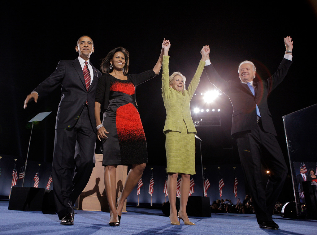 . President-elect Barack Obama and his wife, Michelle, second from left, and Vice President-elect Joe Biden and his wife, Jill, celebrate after Obama\'s acceptance speech at the election night rally in Chicago, Tuesday, Nov. 4, 2008. (AP Photo/Jae C. Hong)