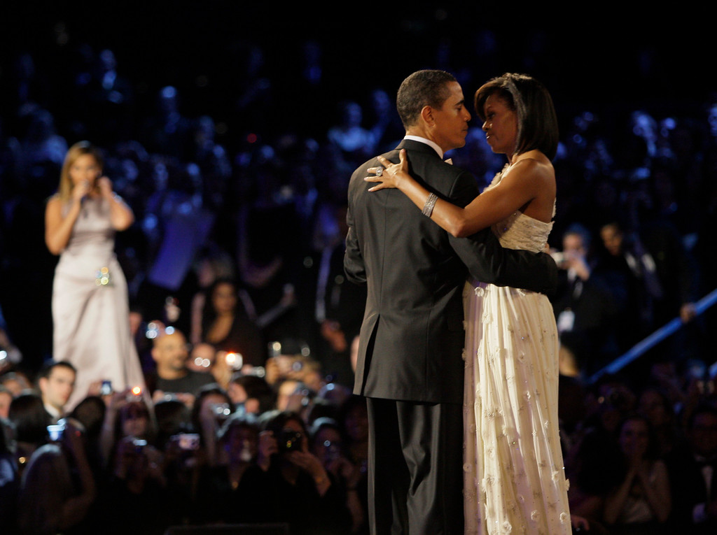 . President Barack Obama, left, and first lady Michelle Obama dance together at the Neighborhood Inaugural Ballin Washington, Tuesday, Jan. 20, 2009.  At rear is singer Beyonce. (AP Photo/Elise Amendola)