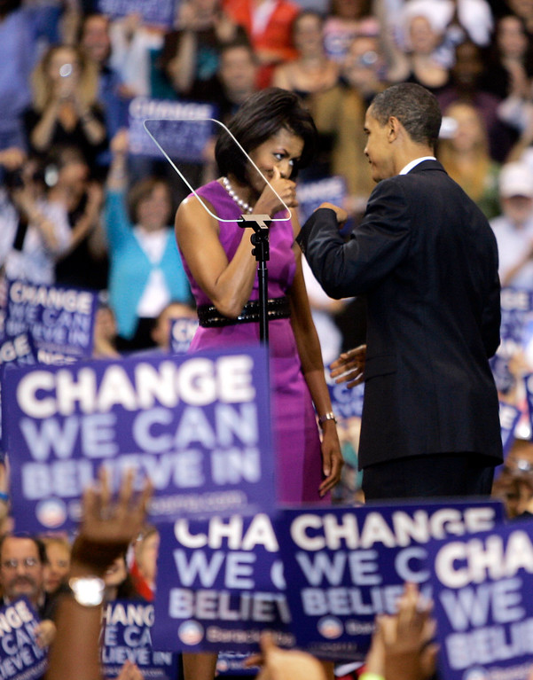 . FILE - This June 3, 2008, file photo shows then-Democratic presidential candidate Sen. Barack Obama fist bump with his wife Michelle, before speaking at a primary night rally in St. Paul, Minn. From his campaign fist bump to his theatrical mic drop at the last White House correspondents� dinner, Barack Obama ruled as America�s pop culture president. His two terms played out like a running chronicle of the trends of our times: slow-jamming the news with Jimmy Fallon, reading mean tweets with Jimmy Kimmel, filling out his NCAA basketball bracket on ESPN, cruising with Jerry Seinfeld on �Comedians in Cars Getting Coffee.� (AP Photo/Morry Gash, File)