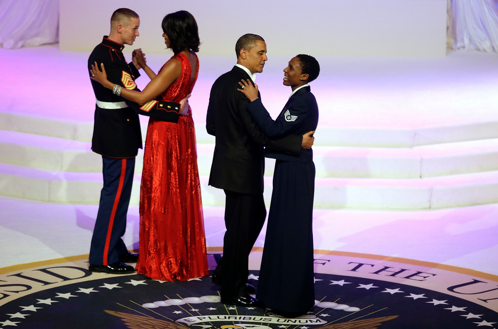 . President Barack Obama and first lady Michelle Obama share a dance with Air Force Staff Sgt Bria Nelson and Marine Corps Gunnery Sgt. Timothy Easterling during the Commander-In-Chief\'s inaugural ball at the Washington Convention Center during the 57th Presidential Inauguration Monday, Jan. 21, 2013 in Washington.  (AP Photo/ Evan Vucci)