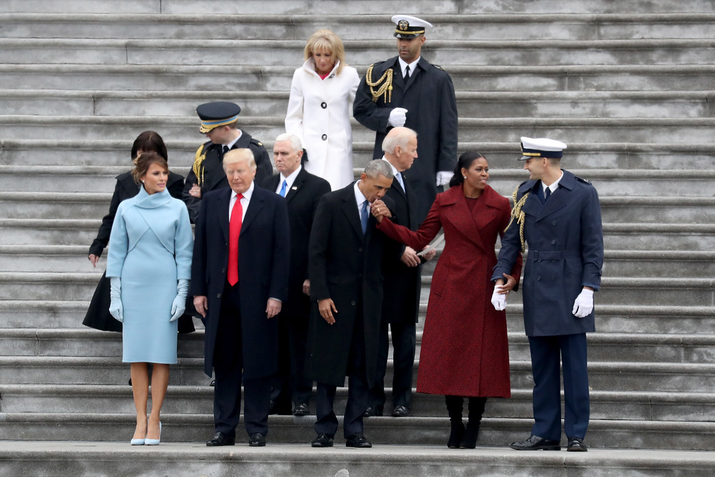 . WASHINGTON, DC - JANUARY 20:  (From L to R) First Lady Melania Trump, President Donald Trump, Vice President Mike Pence, Jill Biden, former president Barack Obama, former vice president Joe Biden,and  Michelle Obama stand on the steps of the U.S. Capitol on January 20, 2017 in Washington, DC. In today\'s inauguration ceremony Donald J. Trump becomes the 45th president of the United States.  (Photo by Rob Carr/Getty Images)