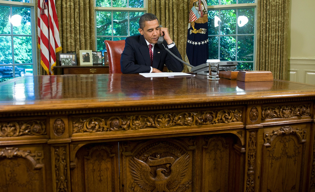 . US President Barack Obama talks on the phone with Astronauts aboard the Space Shuttle Atlantis, while on a mission to repair the Hubble Space Telescope, from the Oval Office of the White House in Washington, DC, May 20, 2009. (SAUL LOEB/AFP/Getty Images)