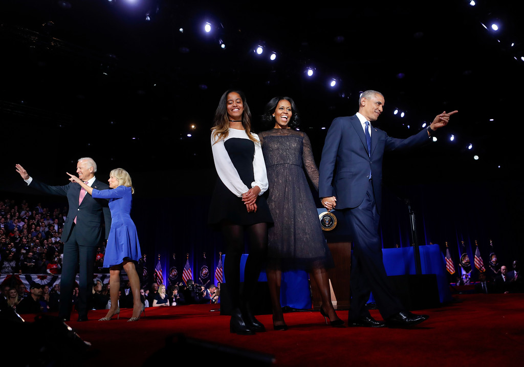 . President Barack Obama points on stage with first lady Michelle Obama, daughter Malia, Vice President Joe Biden and his wife Jill Biden after his farewell address at McCormick Place in Chicago, Tuesday, Jan. 10, 2017. (AP Photo/Pablo Martinez Monsivais)
