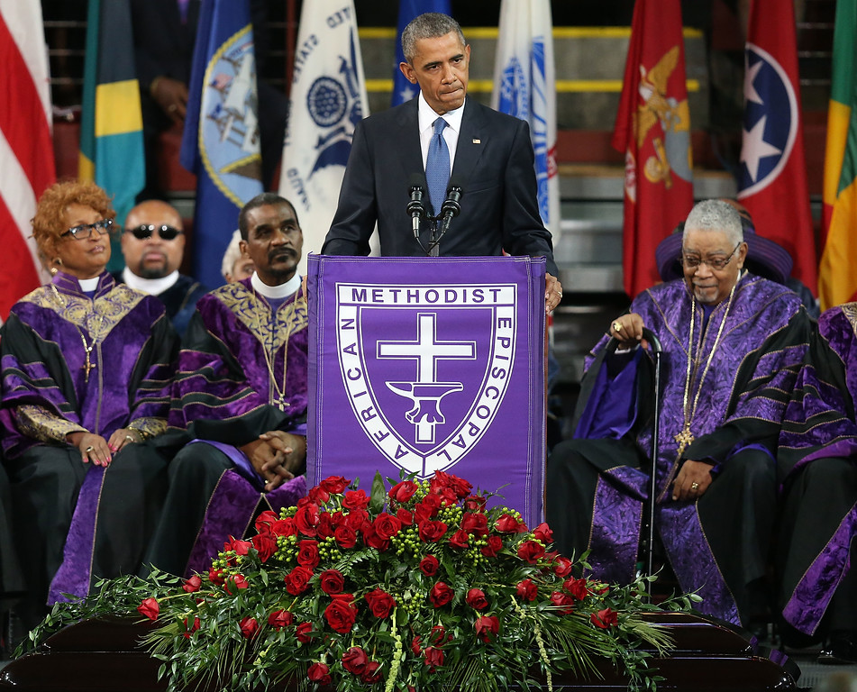 . CHARLESTON, SC - JUNE 26:  President Barack Obama delivers the eulogy for South Carolina state senator and Rev. Clementa Pinckney during Pinckney\'s funeral service June 26, 2015 in Charleston, South Carolina. Suspected shooter Dylann Roof, 21, is accused of killing nine people on June 17th during a prayer meeting in the church, which is one of the nation\'s oldest black churches in Charleston.  (Photo by Joe Raedle/Getty Images)