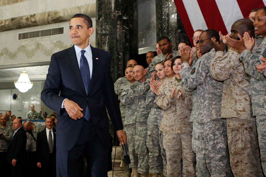 . President Barack Obama is applauded by military personnel during his visit to Camp Victory in Baghdad, Iraq, Tuesday, April 7, 2009. (AP Photo/Charles Dharapak)