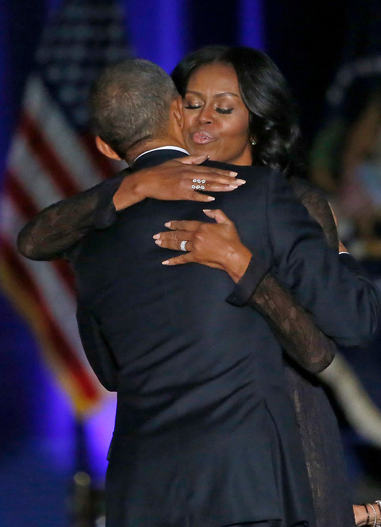 . First Lady Michelle Obama hugs President Barack Obama after President Obama gives his presidential farewell address at McCormick Place in Chicago, Tuesday, Jan. 10, 2017. (AP Photo/Charles Rex Arbogast)