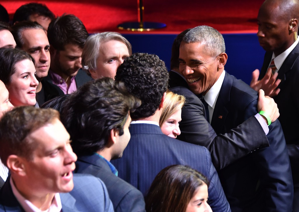 . US President Barack Obama hugs supporters after his farewell address in Chicago, Illinois on January 10, 2017. Barack Obama closes the book on his presidency, with a farewell speech in Chicago that will try to lift supporters shaken by Donald Trump\'s shock election. (NICHOLAS KAMM/AFP/Getty Images)