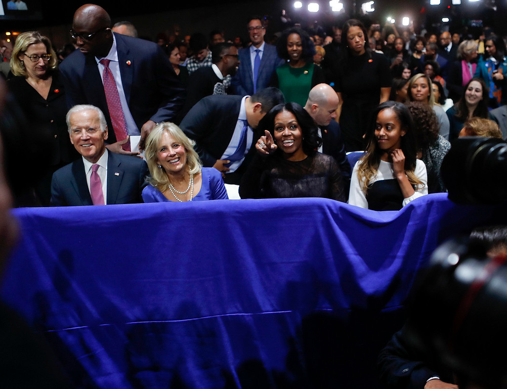 . Sitting in the front row, from left, Vice President Joe Biden, Jill Biden, first lady Michelle Obama and Malia Obama, take their seats to hear President Barack Obama deliver his farewell address at McCormick Place in Chicago, Tuesday, Jan. 10, 2017. (AP Photo/Pablo Martinez Monsivais)
