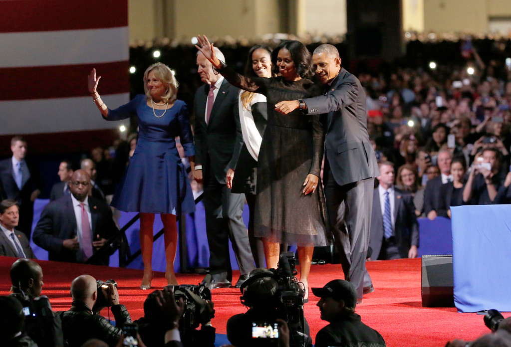 . President Barack Obama is joined by First Lady Michelle Obama, daughter Malia Obama, Vice President Joe Biden and Dr. Jill Biden after giving his presidential farewell address at McCormick Place in Chicago, Tuesday, Jan. 10, 2017. (AP Photo/Nam Y. Huh)