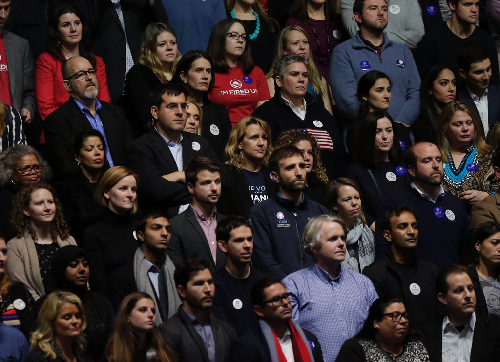 . Supporters lissten as US President Barack Obama speaks during his farewell address in Chicago, Illinois on January 10, 2017. Barack Obama closes the book on his presidency, with a farewell speech in Chicago that will try to lift supporters shaken by Donald Trump\'s shock election. (JOSHUA LOTT/AFP/Getty Images)