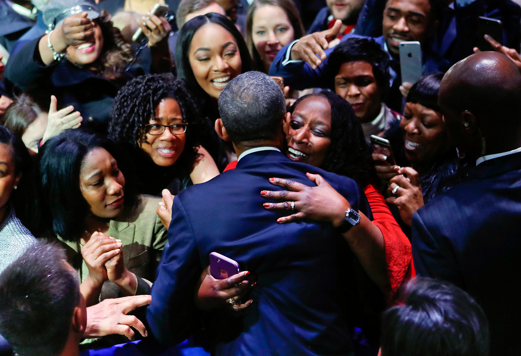 . President Barack Obama is embraced by a woman in the crowd as he greets supporters after his farewell address at McCormick Place in Chicago, Tuesday, Jan. 10, 2017. (AP Photo/Pablo Martinez Monsivais)