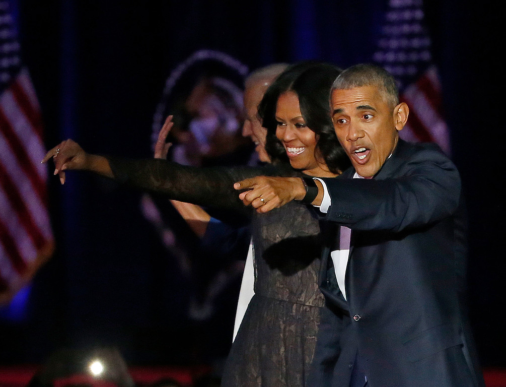 . President Barack Obama waves as he is joined by First Lady Michelle Obama after giving his presidential farewell address at McCormick Place in Chicago, Tuesday, Jan. 10, 2017. (AP Photo/Charles Rex Arbogast)