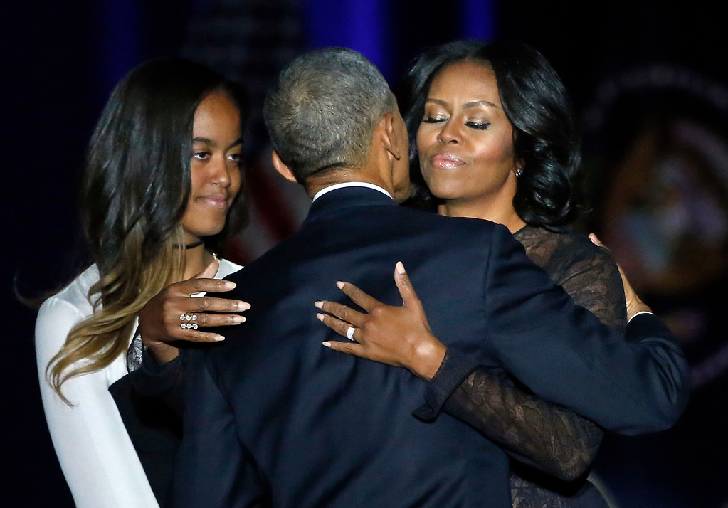 . President Barack Obama is joined by his First Lady Michelle Obama and his daughter Malia after giving his presidential farewell address at McCormick Place in Chicago, Tuesday, Jan. 10, 2017. (AP Photo/Charles Rex Arbogast)