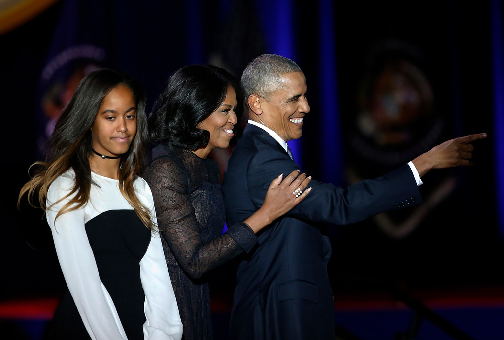 . President Barack Obama points as he is joined by First Lady Michelle Obama and his daughter Malia Obama after giving his presidential farewell address at McCormick Place in Chicago, Tuesday, Jan. 10, 2017. (AP Photo/Charles Rex Arbogast)