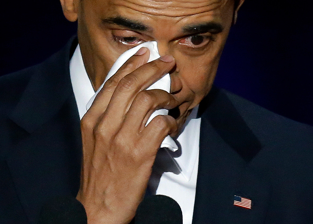. President Barack Obama wipes his tears as he speaks at McCormick Place in Chicago, Tuesday, Jan. 10, 2017, giving his presidential farewell address. (AP Photo/Charles Rex Arbogast)
