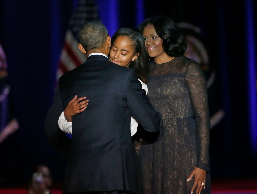 . President Barack Obama is joined by his daughter Malia and First Lady Michelle Obama after giving his presidential farewell address at McCormick Place in Chicago, Tuesday, Jan. 10, 2017. (AP Photo/Charles Rex Arbogast)