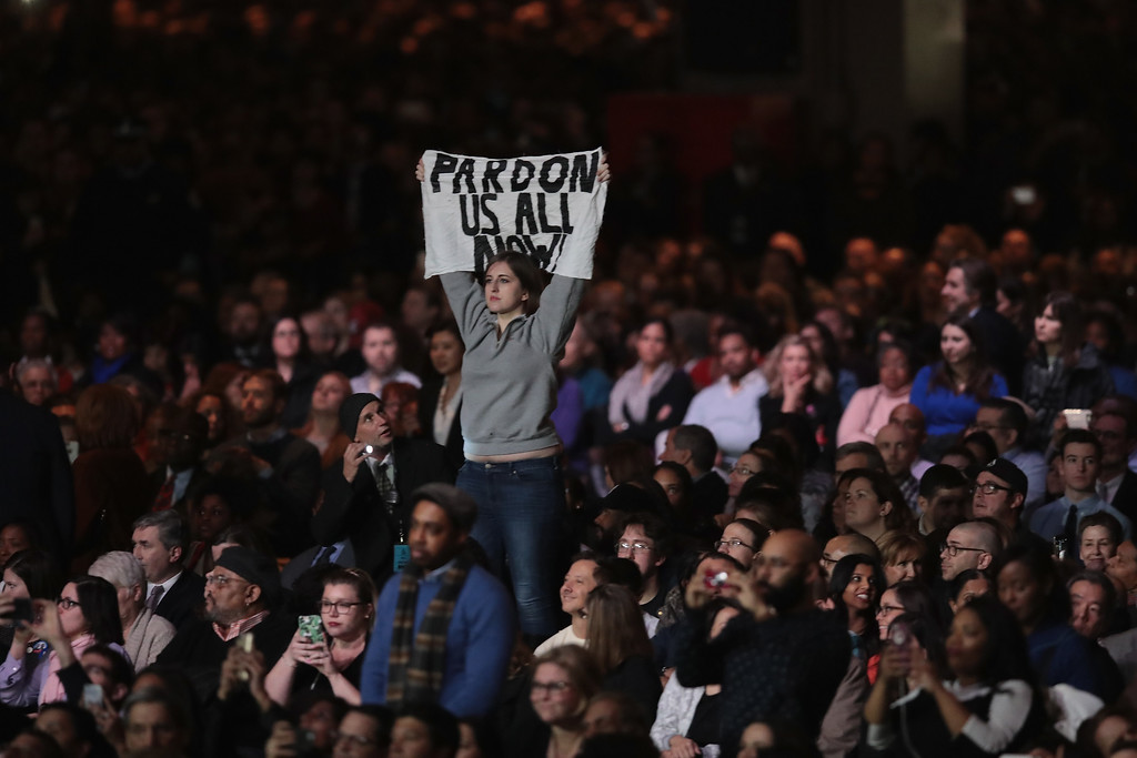 . CHICAGO, IL - JANUARY 10:  A demonstrator holds up a banner as President Barack Obama delivers a farewell speech to the nation on January 10, 2017 in Chicago, Illinois. President-elect Donald Trump will be sworn in the as the 45th president on January 20.  (Photo by Scott Olson/Getty Images)