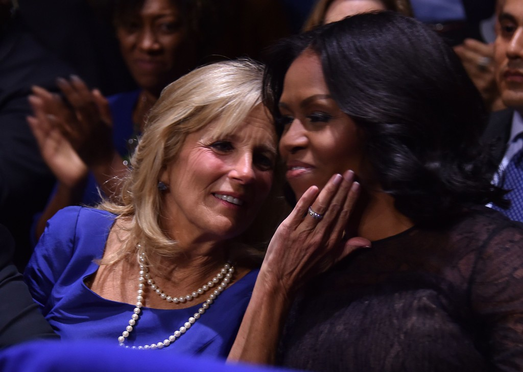 . US first lady Michelle Obama (R) and the Vice Presidents wife, Jill Biden, hug as US President Barack Obama speaks during his farewell address in Chicago, Illinois on January 10, 2017. Barack Obama closes the book on his presidency, with a farewell speech in Chicago that will try to lift supporters shaken by Donald Trump\'s shock election. (NICHOLAS KAMM/AFP/Getty Images)