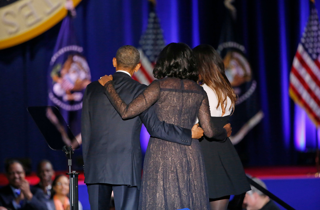 . President Barack Obama is joined by First Lady Michelle Obama and his daughter Malia Obama after giving his presidential farewell address at McCormick Place in Chicago, Tuesday, Jan. 10, 2017. (AP Photo/Charles Rex Arbogast)