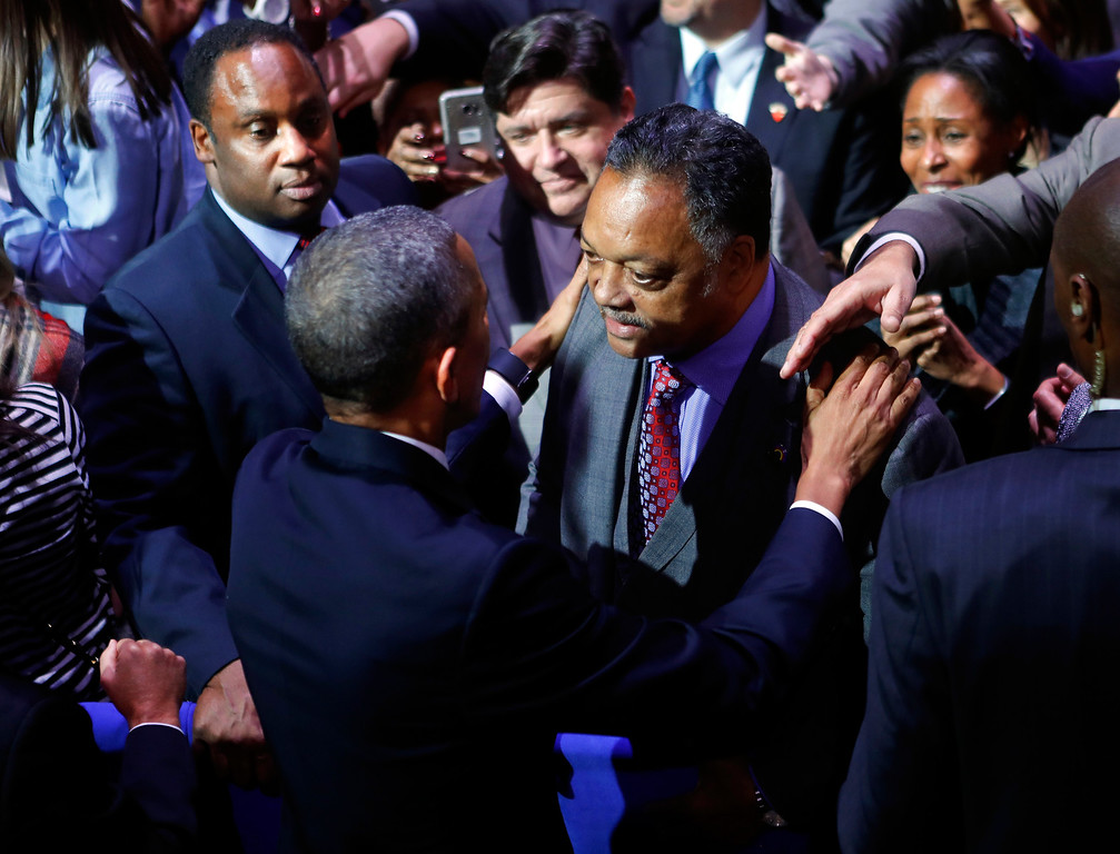 . President Barack Obama talks with Rev. Jesse Jackson following his farewell address at McCormick Place in Chicago, Tuesday, Jan. 10, 2017. On the left is Jackson\'s son Jonathan Jackson. (AP Photo/Pablo Martinez Monsivais)