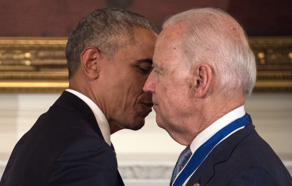 . US Vice President Joe Biden and President Barack Obama embrace after Obama awarded him the Presidential Medal of Freedom during a tribute to Biden at the White House in Washington, DC, on January 12, 2017. (NICHOLAS KAMM/AFP/Getty Images)