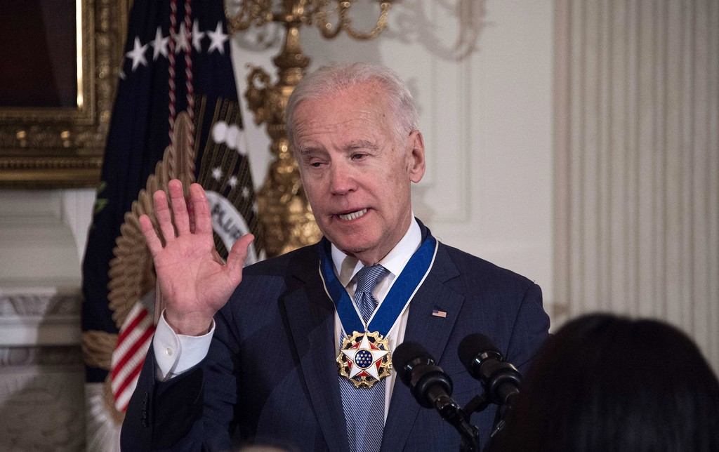 . US Vice President Joe Biden acknoledges applause after President Barack Obama awarded him the Presidential Medal of Freedom during a tribute to Biden at the White House in Washington, DC, on January 12, 2017. (NICHOLAS KAMM/AFP/Getty Images)