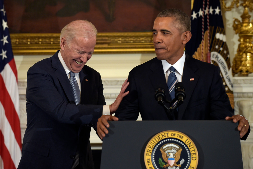 . Vice President Joe Biden laughs as President Barack Obama talks about him during a ceremony in the State Dining Room of the White House in Washington, Thursday, Jan. 12, 2017. Obama surprised Biden an presented him with the Presidential Medal of Freedom. (AP Photo/Susan Walsh)