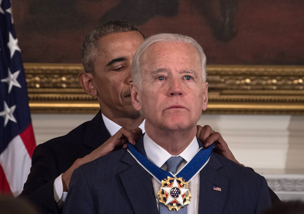 . US President Barack Obama awards Vice President Joe Biden the Presidential Medal of Freedom during a tribute to Biden at the White House in Washington, DC, on January 12, 2017. / AFP / NICHOLAS KAMM        (Photo credit should read NICHOLAS KAMM/AFP/Getty Images)