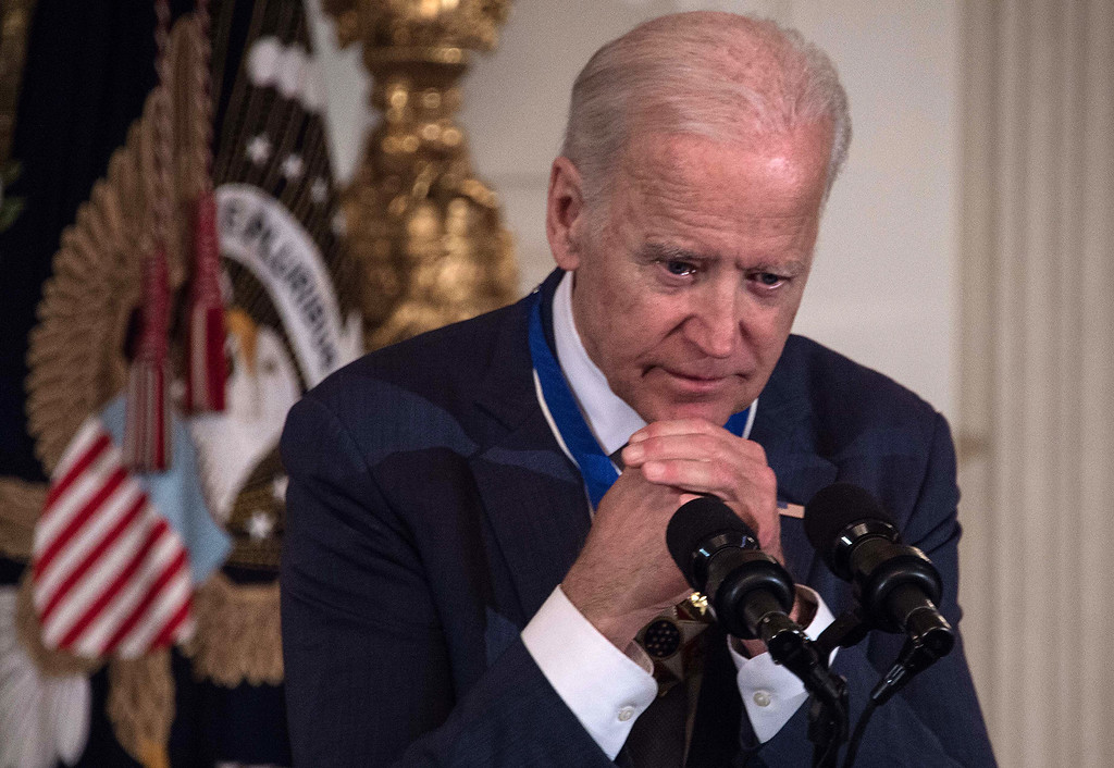 . US Vice President Joe Biden speaks after President Barack Obama awarded him the Presidential Medal of Freedom during a tribute to Biden at the White House in Washington, DC, on January 12, 2017. / AFP / NICHOLAS KAMM        (Photo credit should read NICHOLAS KAMM/AFP/Getty Images)