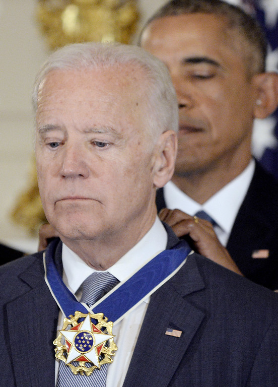 . WASHINGTON, DC - JANUARY 12:  (AFP OUT) U.S. President Barack Obama (R) presents the Medal of Freedom to Vice-President Joe Biden during an event  in the State Dinning room of the White House, January 12, 2017 in Washington, DC.  (Photo by Olivier Douliery-Pool/Getty Images)