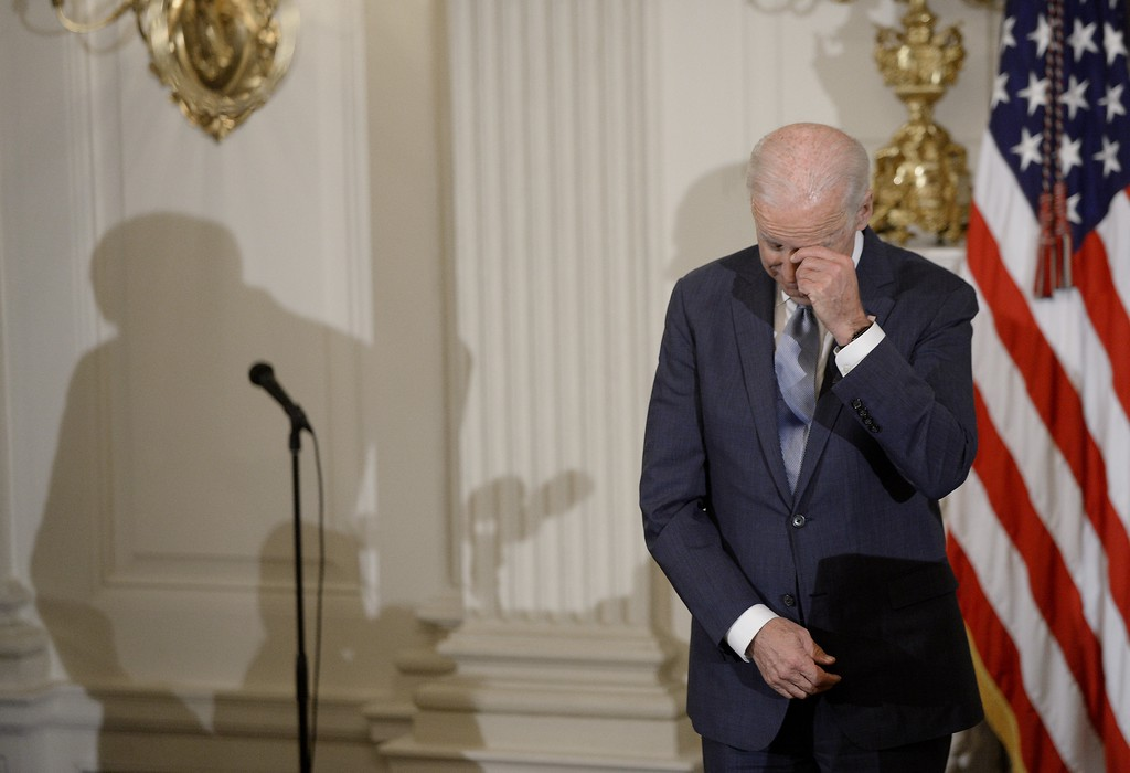 . WASHINGTON, DC - JANUARY 12:  (AFP OUT) U.S. Vice President Joe Biden wipes his eyes as Preident Barack Obama presents him with Medal of Freedom during an event  in the State Dinning room of the White House January 12, 2017 in Washington, DC. (Photo by Olivier Douliery-Pool/Getty Images)
