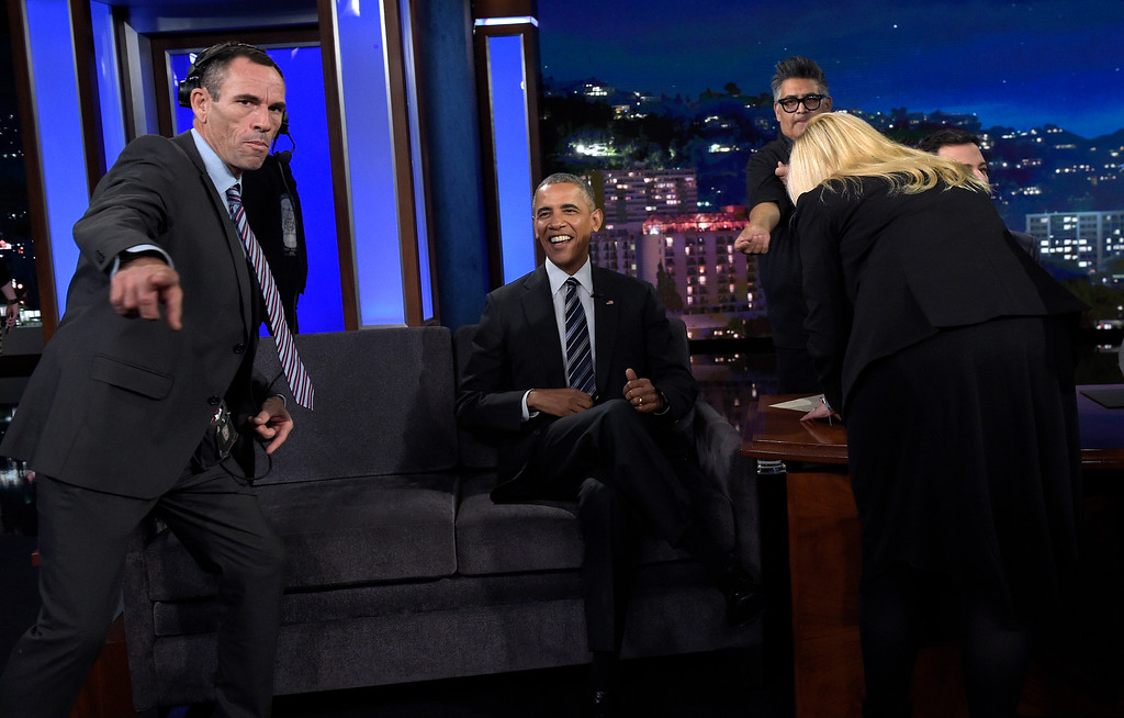 . President Barack Obama talks with Jimmy Kimmel in between taping segments of Jimmy Kimmel Live! at the El Capitan Entertainment Center in Los Angeles, Monday, Oct. 24, 2016. Obama is spending a few days in on the West Coast campaigning and will taped an episode of Jimmy Kimmel Live!. (AP Photo/Susan Walsh)