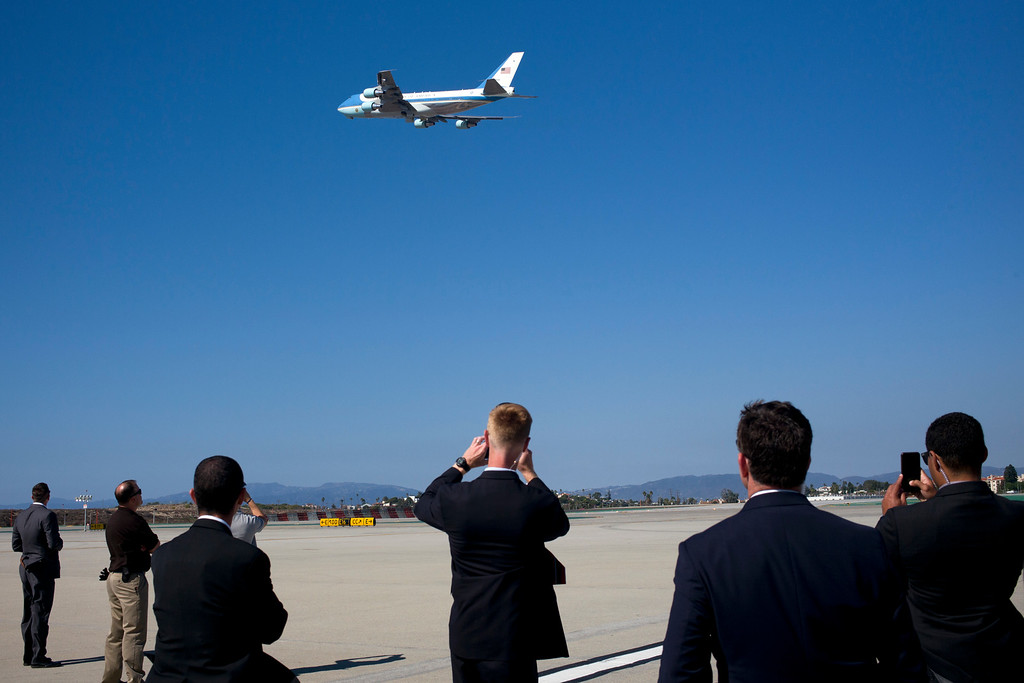 . Secret Service agents watch as Air Force One, with President Barack Obama aboard, takes off from the Los Angeles International Airport Tuesday, Oct. 25, 2016, in Los Angeles, en route to Washington. (AP Photo/Jae C. Hong)