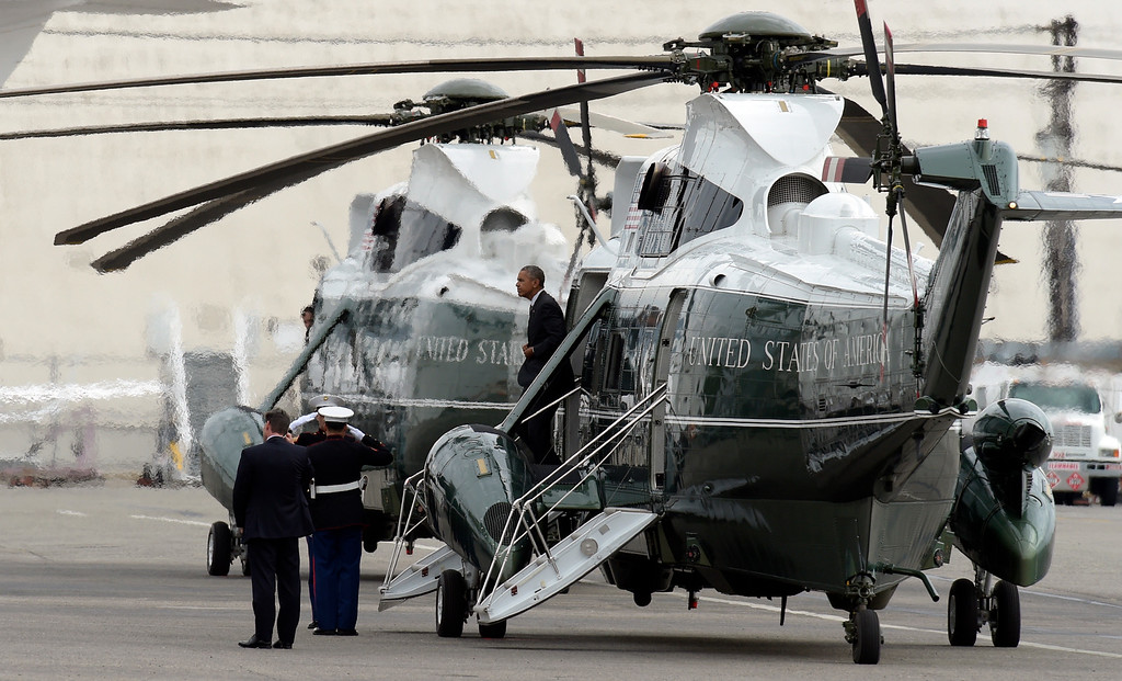 . President Barack Obama walks off of Marine One after landing at Bob Hope Airport in Burbank, Calif., Monday, Oct. 24, 2016. Obama is spending a few days in on the West Coast campaigning and will tape an episode of Jimmy Kimmel Live!. (AP Photo/Susan Walsh)