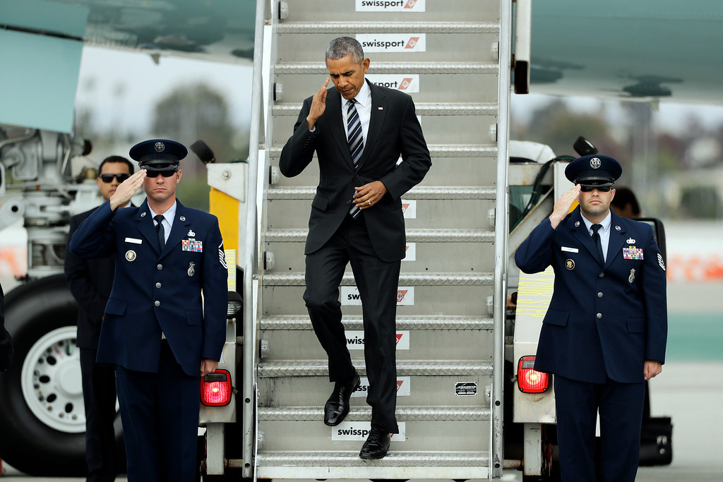 . President Barack Obama salutes as he walks down the steps of Air Force One at the Los Angeles International Airport Monday, Oct. 24, 2016, in Los Angeles. (AP Photo/Jae C. Hong)