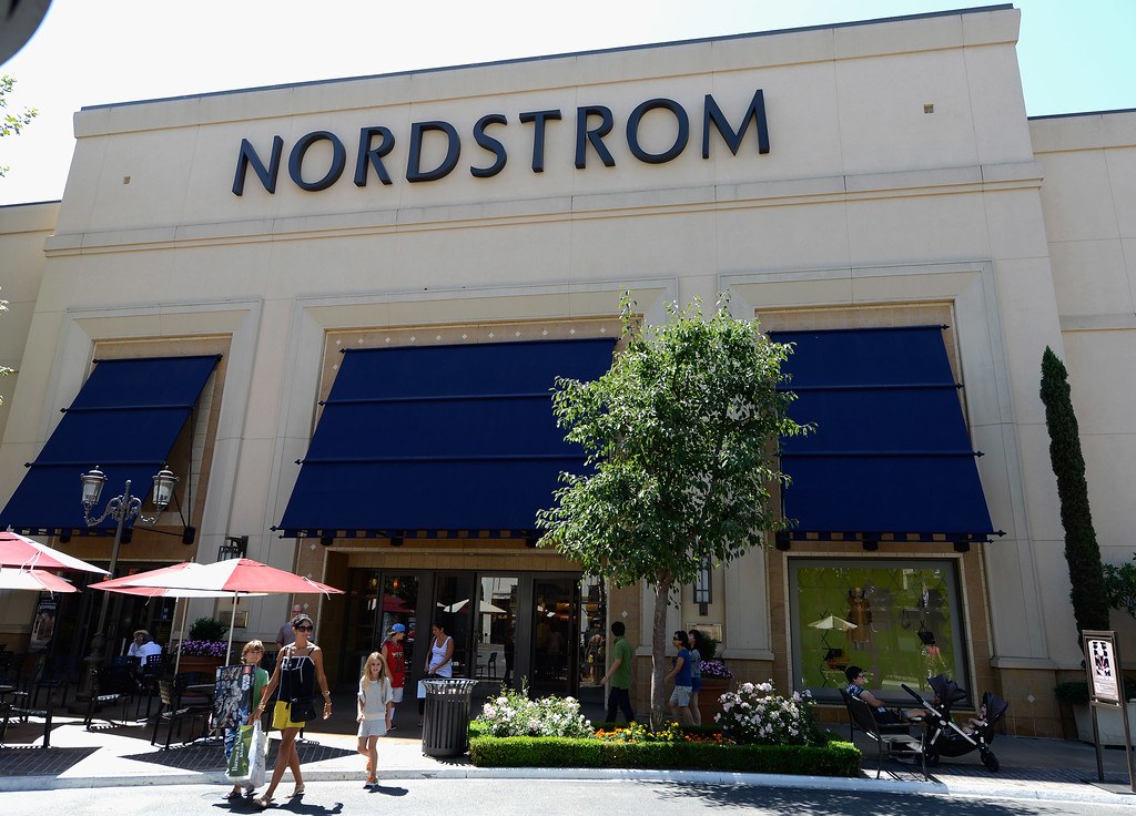 . Shoppers walk out of the Nordstrom department store on August 14, 2012 in Los Angeles, California. Nordstrom shares sunk after President Trump tweeted that the department store chain had treated his daughter �so unfairly� when it announced last week that it would stop selling Ivanka Trump�s clothing and accessory line. Nordstrom shares sunk after President Trump tweeted that the department store chain had treated his daughter �so unfairly� when it announced last week that it would stop selling Ivanka Trump�s clothing and accessory line.  (Photo by Kevork Djansezian/Getty Images)