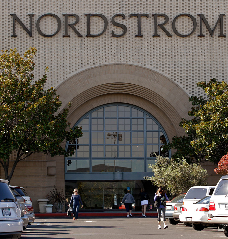 . In this Nov. 7, 2011 photo, shoppers enter Nordstrom department store, at the Stoneridge shopping center in Pleasanton, Calif. Nordstrom shares sunk after President Trump tweeted that the department store chain had treated his daughter �so unfairly� when it announced last week that it would stop selling Ivanka Trump�s clothing and accessory line. Nordstrom shares sunk after President Trump tweeted that the department store chain had treated his daughter �so unfairly� when it announced last week that it would stop selling Ivanka Trump�s clothing and accessory line.  (AP Photo/Ben Margot)